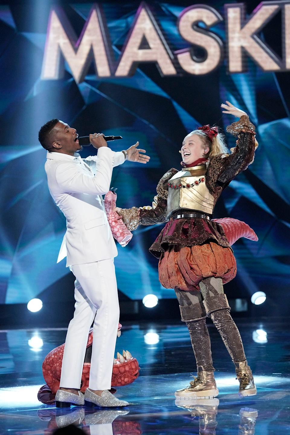 """JoJo Siwa was revealed to be the T-Rex on season 3 of """"The Masked Singer."""""""