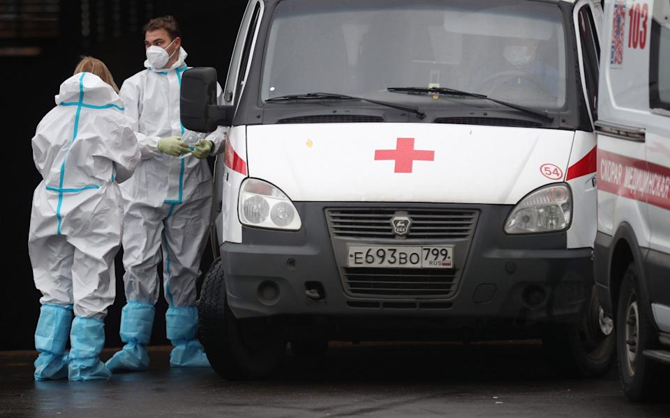 Emergency paramedics and an ambulance by the Novomoskovsky multipurpose medical center for patients with suspected COVID-19 coronavirus infection - Mikhail Tereshcenko/TASS via Getty Images