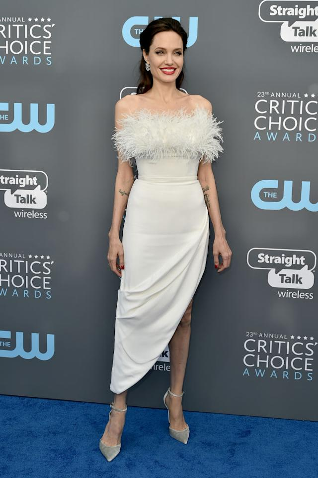 <p>For the awards ceremony, Angelina Jolie made a rare appearance in a cold-shoulder Ralph & Russo dress emblazoned with cream feathers. <em>[Photo: Getty]</em> </p>