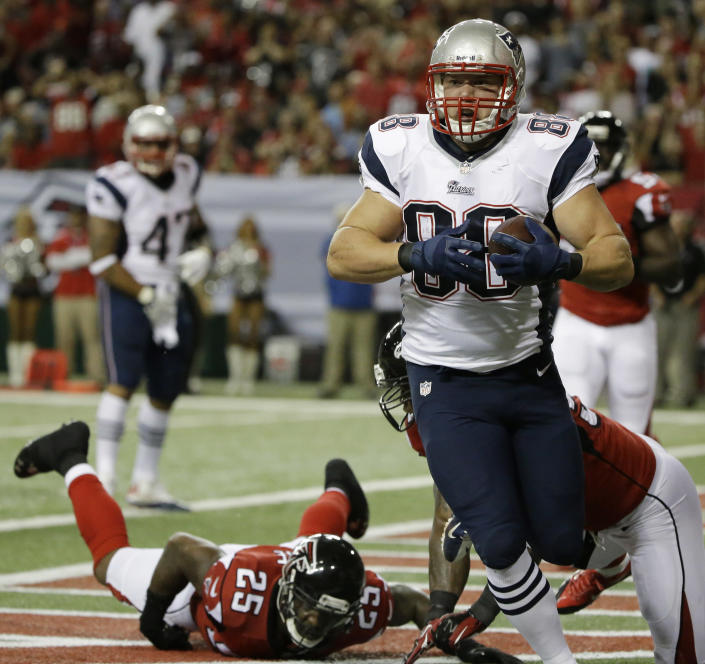 New England Patriots tight end Matthew Mulligan (88) catches a ball for a touchdown against the Atlanta Falcons during the first half of an NFL football game, Sunday, Sept. 29, 2013, in Atlanta. (AP Photo/David Goldman)
