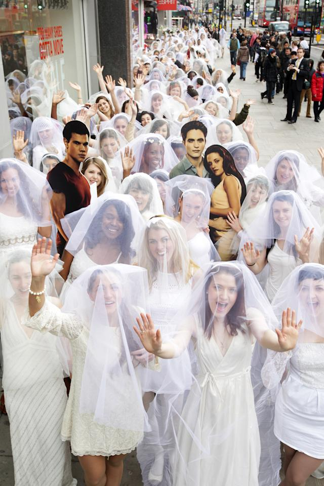 LONDON, ENGLAND - MARCH 11:  Entertainment One is attempting to set the Guinness World Record for the longest chain of brides in one location - on March 11, 2012 in London, United Kingdom. The event was held to celebrate to celebrate the DVD release of The Twilight Saga: Twilight Breaking Dawn Part 1  (Photo by Dave J Hogan/Getty Images)
