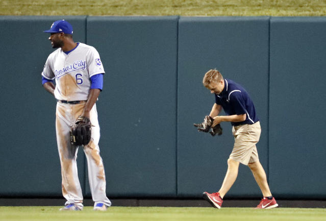 <p>Kansas City Royals center fielder Lorenzo Cain waits as a member of the Busch Stadium grounds crew removes a cat that wandered onto the field during the sixth inning of the Royalss baseball game against the St. Louis Cardinals on Wednesday, Aug. 9, 2017, in St. Louis. (AP Photo/Jeff Roberson) </p>