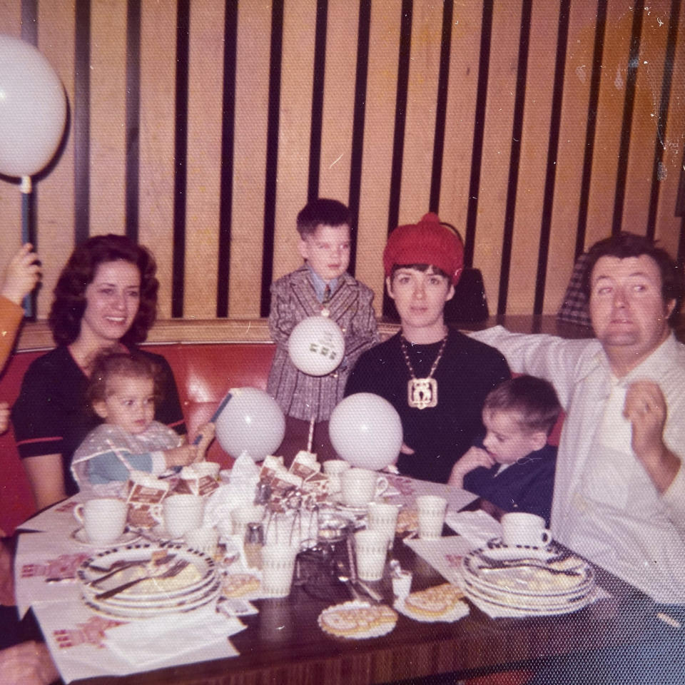 This undated photo provided by the family in May 2020 shows Joe Sullivan, second right, of the Chicago-area, during a party. (Family photo via AP)