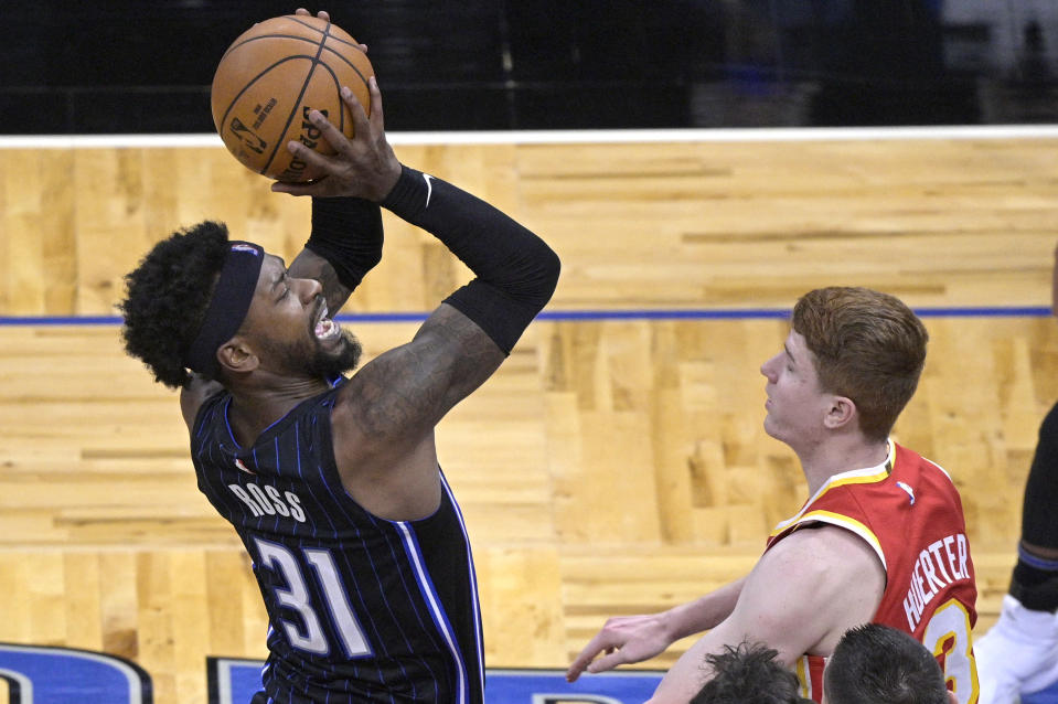 Orlando Magic guard Terrence Ross (31) shoots in front of Atlanta Hawks guard Kevin Huerter (3) during the second half of an NBA basketball game Wednesday, March 3, 2021, in Orlando, Fla. (AP Photo/Phelan M. Ebenhack)
