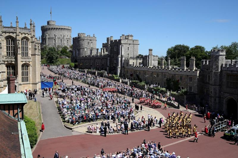 Guards of the Blues and Royals regiment and the military band march around the crowds at Windsor Castle (Getty Images)
