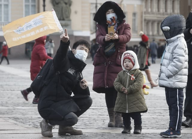 Chinese tourists wearing protective face masks in St Petersburg, Russia