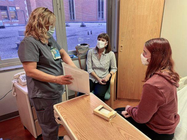 PHOTO: Clinical research coordinator Stacy Ranz discusses procedures with Katelyn Evans, 16, and her mom Laurie Evans ahead of injection in Pfizer COVID-19 vaccine trial. (Courtesy Cincinnati Children's)