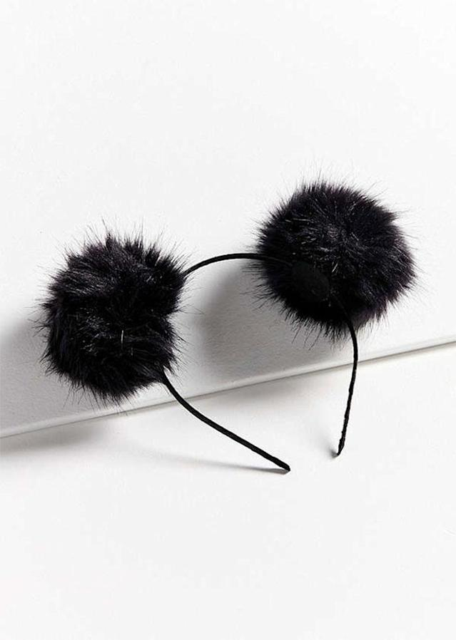 "Sometimes, the best things come in pairs. $14; at <a href=""https://www.urbanoutfitters.com/shop/fluffy-pompom-ear-headband?category=hair-accessories-for-women&color=001"" rel=""nofollow noopener"" target=""_blank"" data-ylk=""slk:Urban Outfitters"" class=""link rapid-noclick-resp"">Urban Outfitters</a>"