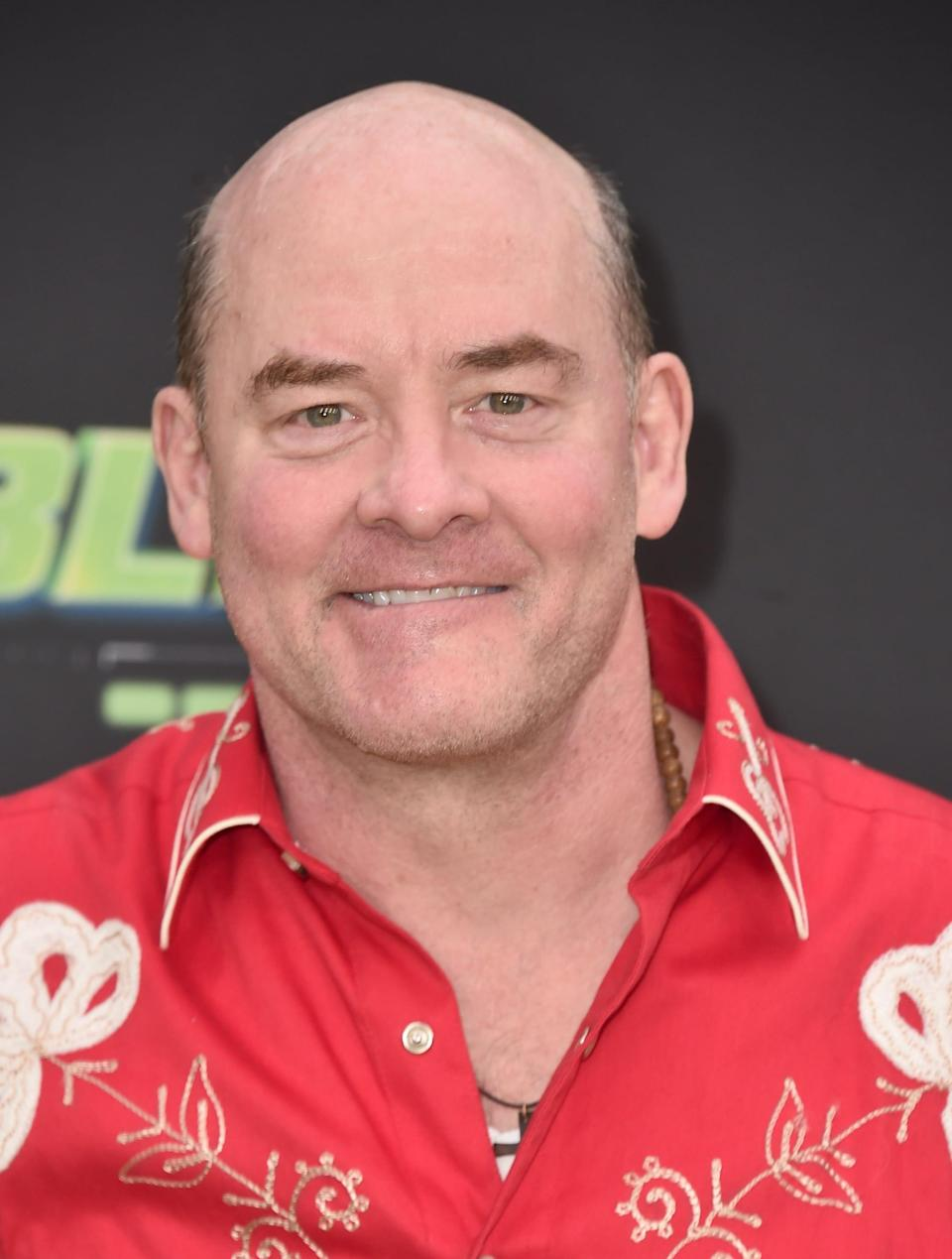 """<p>Comedian Koechner has the kind of résumé plenty of people dream about. He's been working steadily for decades, starting out in the '90s on <strong><a class=""""link rapid-noclick-resp"""" href=""""https://www.popsugar.co.uk/Saturday-Night-Live"""" rel=""""nofollow noopener"""" target=""""_blank"""" data-ylk=""""slk:Saturday Night Live"""">Saturday Night Live</a></strong> and moving on to roles like <strong>The Office</strong>'s Todd Packer and recurring spots on <strong>The Goldbergs</strong>, <strong>Bless This Mess</strong>, and more. Koechner also has appeared in a number of popular comedy movies, including <strong>Anchorman 2</strong>, and <strong>Get Smart</strong>.</p>"""