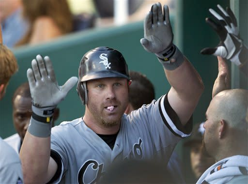 Chicago White Sox's Adam Dunn is congratulated by teammate after his solo home run during the sixth inning of a baseball game against the Kansas City Royals in Kansas City, Mo., Saturday, July 14, 2012. (AP Photo/Orlin Wagner)