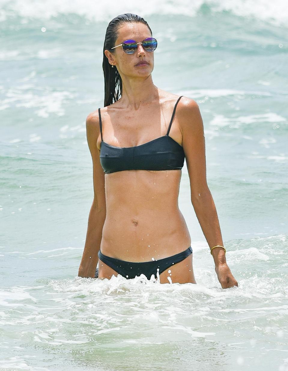 <p>Alessandra Ambrosio hits the water to exercise at the beach in Brazil on Tuesday.</p>