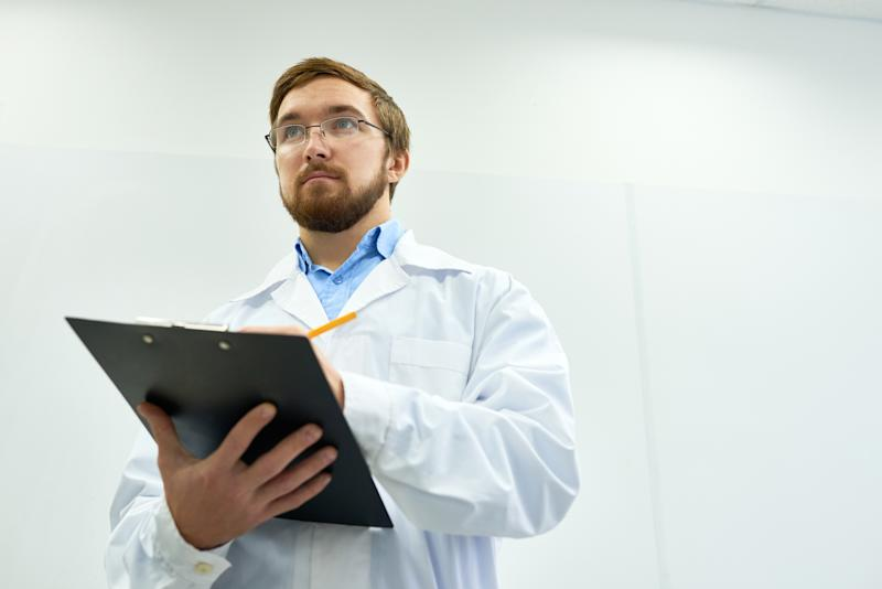 Guy in a labcoat with a clipboard.