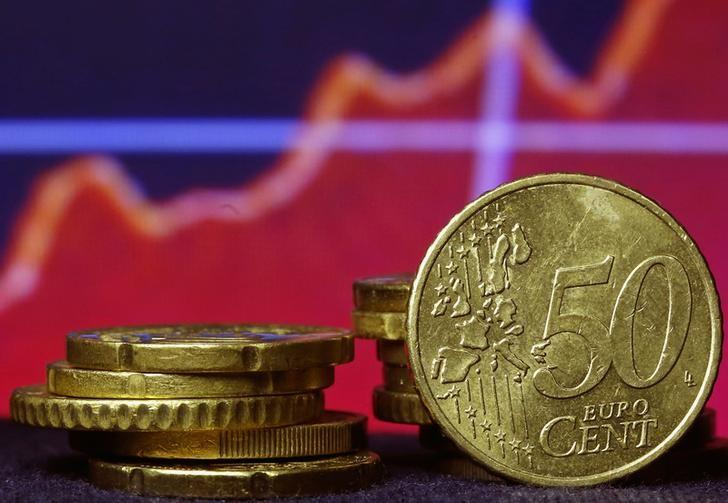 Euro coins are seen in front of a displayed stock graph in this picture illustration taken in Zenica