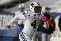 BYU running back Lopini Katoa (4) carries the ball for a touchdown against Western Kentucky during the first half of an NCAA college football game Saturday, Oct. 31, 2020, in Provo, Utah. (AP Photo/Rick Bowmer, Pool)