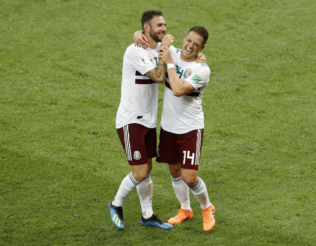 Mexico's Miguel Layun, left, and teammate Javier Hernandez celebrate after their team's 2-1 win over South Korea in their group F match at the 2018 soccer World Cup in the Rostov Arena in Rostov-on-Don, Russia, Saturday, June 23, 2018. (AP Photo/Efrem Lukatsky)