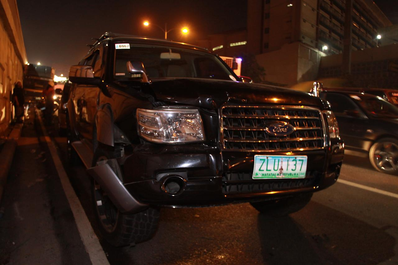 Seen around the area where the multi-vehicular accident happened involving 11 vehicles at the northbound lane of C5 road in Makati city, south of Manila on 09 November 2012. Reports stated that 1 motorcycle rider was dead on the spot and at least 12 others were injured. (George Calvelo/NPPA Images)