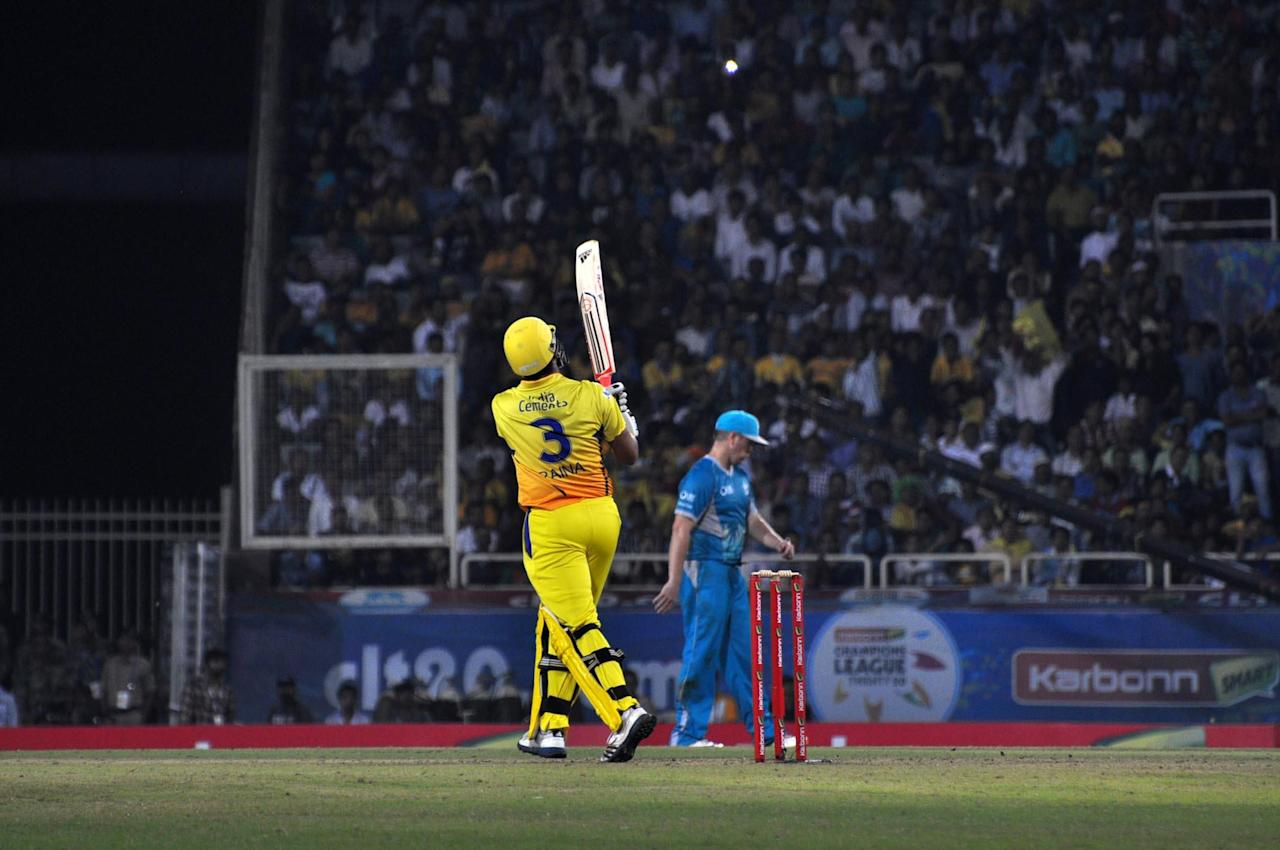 Chennai Super Kings batsman Suresh Raina plays a shot during the match against Brisbane Heat in the CLT20 at JSCA Stadium in Ranchi on Sept. 28, 2013. (Photo: IANS)