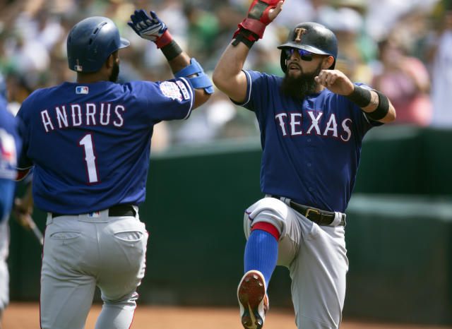 Texas Rangers' Elvis Andrus (1) celebrates his two-run home with teammate Rougned Odor during the first inning of a baseball game against the Oakland Athletics, Sunday, Sept. 22, 2019, in Oakland, Calif. (AP Photo/D. Ross Cameron)