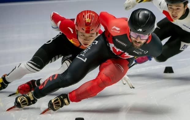 Canadian short track speed skater Charles Hamelin, right, will be competing in his 17th world championship next month in the Netherlands.