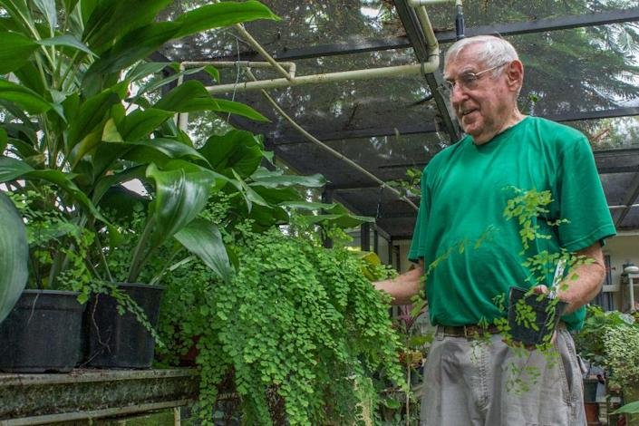 A man gardens at Florida's East Ridge retirement village, where many residents here are taking part in a University of Miami study that seeks to uncover the secrets of healthy aging and staying sharp well into the 90s (AFP Photo/Federica Narancio)