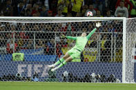 <p>England goalkeeper Jordan Pickford goes airborne to make a save a powerful shot from Mateus Uribe. But from the resutling corner…. </p>