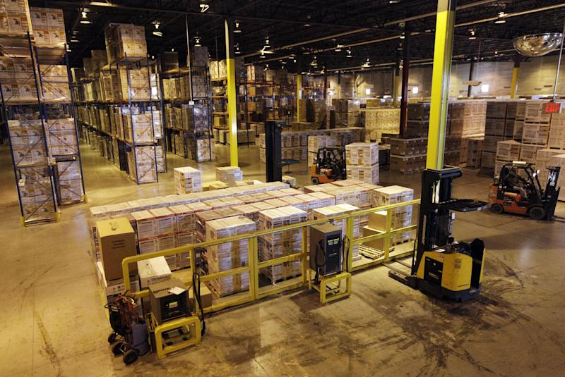 In this Friday, Nov. 16, 2012, photo, employees work at a shipping area of Generac Power Systems, Inc., one of the largest makers of residential generators in the U.S., in Whitewater, Wis.   U.S. companies increased their stockpiles a steady pace in November from October, responding to a solid increase in sales.The Commerce Department said Tuesday that business inventories grew 0.3 percent in November, matching the October gain. (AP Photo/Nam Y. Huh)