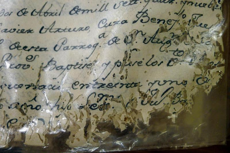 This Saturday, Jan. 27, 2013 photo shows a yellow and deteriorating document in the Historical Archives of the Catholic Diocese of St. Augustine, in St. Augustine, Fla. A University of South Florida professor is digitizing thousands of pages of these documents, which date back to the late 16th Century and record the births, deaths, marriages and baptisms of the early St. Augustine residents. (AP Photo/Tamara Lush)