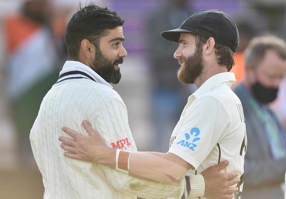 Virat Kohli (pictured left) interacts with Kane Williamson (pictured right) after  Day 6 of the ICC World Test Championship Final between India and New Zealand at The Hampshire Bowl on June 23, 2021 in Southampton, England.