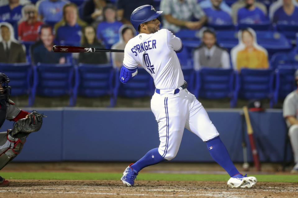 Toronto Blue Jays; George Springer lines out against the Washington Nationals during the fifth inning of a baseball game Wednesday, April 28, 2021, in Dunedin, Fla. (AP Photo/Mike Carlson)