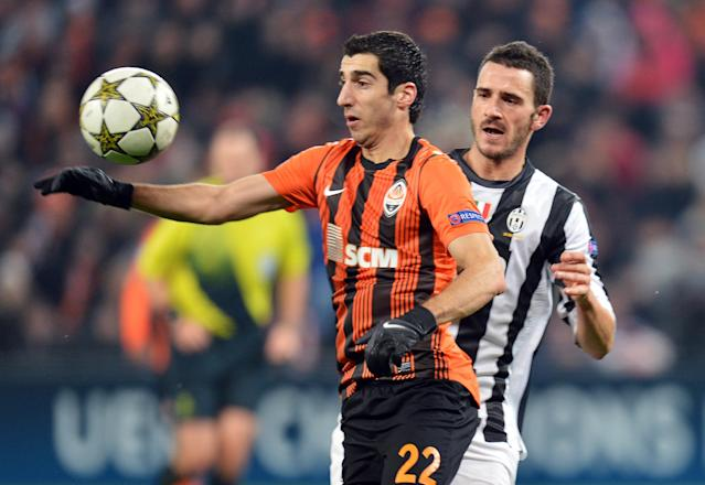 FC Shakhtar's Henrikh Mkhitaryan (L) vies for the ball with Juventus' Mirko Vucinic during the UEFA Champions League, Group E, football match between FC Shakhtar and Juventus, in Donetsk on December 5, 2012. AFP PHOTO/ SERGEI SUPINSKYSERGEI SUPINSKY/AFP/Getty Images