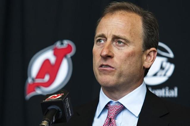 Joshua Harris speaks to the media while he attends an NHL hockey news conference announcing the new owners of the New Jersey Devils at Prudential center in Newark