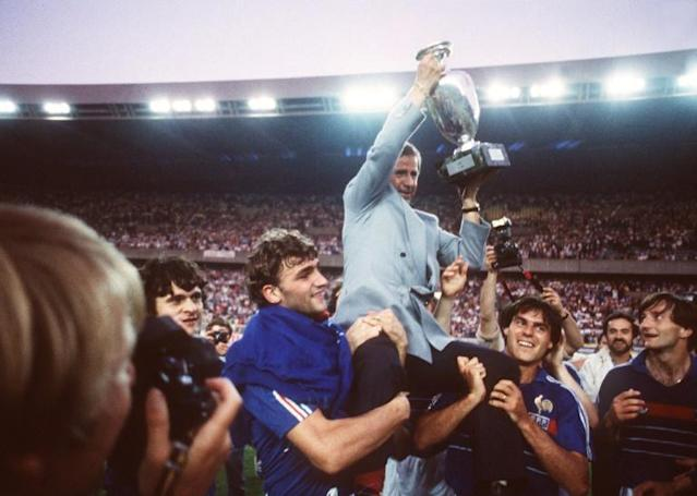 (FILES) Michel Hidalgo, carried by several France players, holds aloft the European Championship trophy after their 2-0 win over Spain in the final in 1984 (AFP Photo/-)