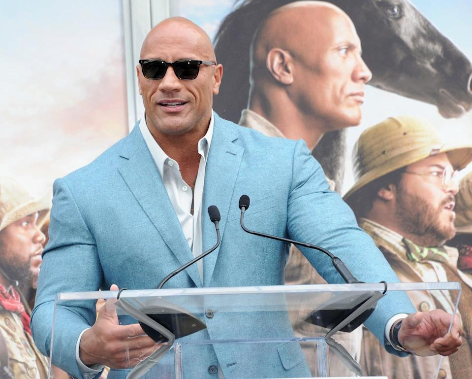 HOLLYWOOD, CA - DECEMBER 10:  Dwayne Johnson speaks at  Kevin Hart's Hand And Footprint Ceremony At the TCL Chinese Theatre IMAX held at TCL Chinese Theatre on December 10, 2019 in Hollywood, California.  (Photo by Albert L. Ortega/Getty Images)
