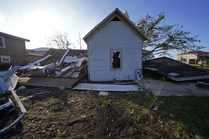 A destroyed home is seen in the aftermath of Hurricane Laura and Hurricane Delta, in Grand Lake, La., Friday, Dec. 4, 2020. (AP Photo/Gerald Herbert)