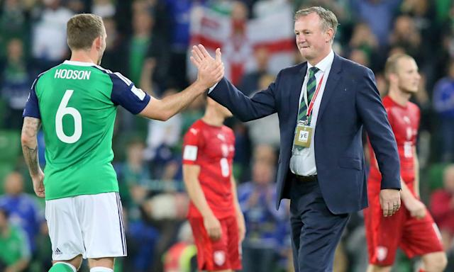 Michael O'Neill celebrates Northern Ireland's win over the Czech Republic in September with Lee Hodson. His team face Switzerland in a World Cup play-off, with the first leg in Belfast on Thursday.