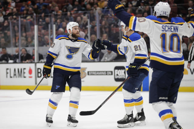 St. Louis Blues' Ryan O'Reilly, left, celebrates his goal with Tyler Bozak and Brayden Schenn during the first period of the team's NHL hockey game against the Anaheim Ducks on Wednesday, March 6, 2019, in Anaheim, Calif. (AP Photo/Jae C. Hong)