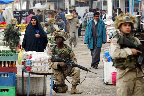 PHOTO: U.S. soldiers patrol a market in downtown Tikrit, Iraq, Dec. 16, 2003. (Mauricio Lima/AFP via Getty Images, FILE)
