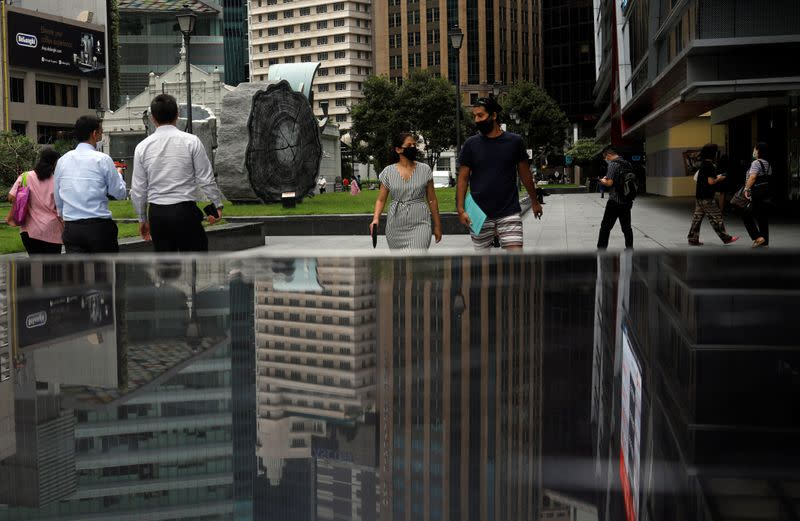 People walk at the central business district in Singapore