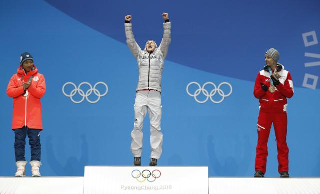 Medals Ceremony - Nordic Combined Events - Pyeongchang 2018 Winter Olympics - Men's Individual 10km - Medals Plaza - Pyeongchang, South Korea - February 15, 2018 - Gold medalist Eric Frenzel of Germany, silver medalist Akito Watabe of Japan and bronze medalist Lukas Klapfer of Austria on the podium. REUTERS/Kim Hong-Ji