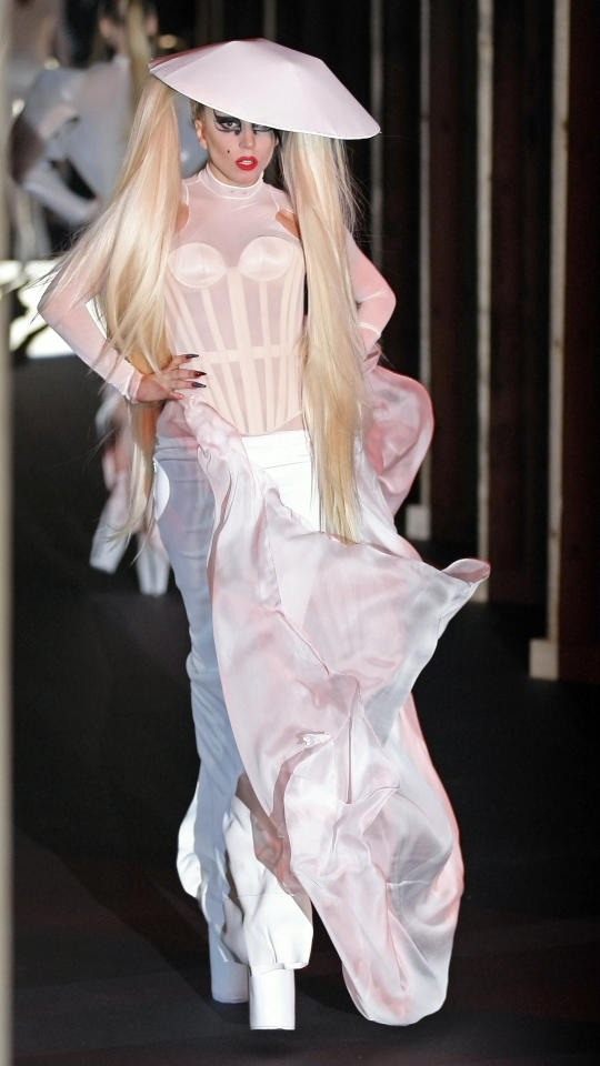 Lady Gaga shows a creation, part of French designer Thierry Mugler Fall-Winter ready-to-wear 2012, fashion collection, presented in Paris, Wednesday, March 2, 2011.