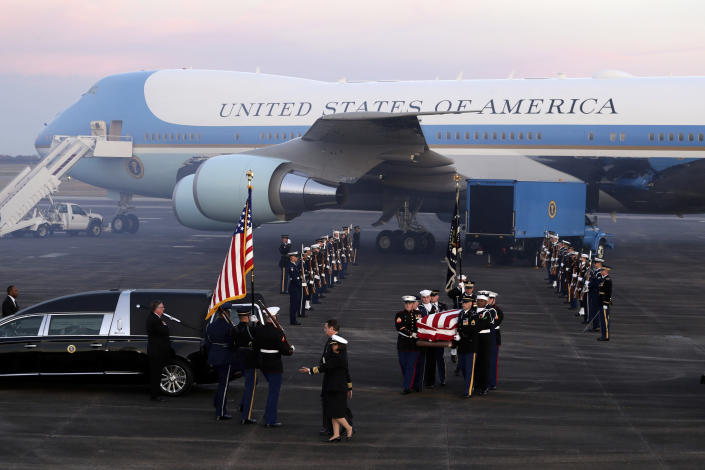 The flag-draped casket of former President George H.W. Bush is carried by a joint services military honor guard Wednesday, Dec. 5, 2018, at Ellington Field in Houston. (Photo: Eric Gay/AP)