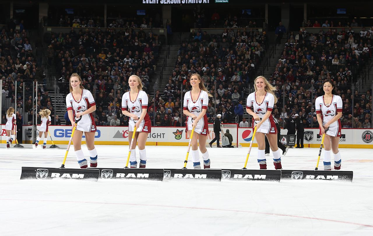 <p>Members of the Colorado Avalanche ice girls clear the ice during a time out against the Los Angeles Kings at the Pepsi Center on January 4, 2016 in Denver, Colorado. (Photo by Michael Martin/NHLI via Getty Images) </p>