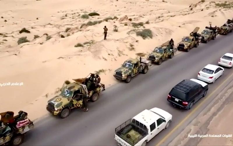 An aerial view shows military vehicles on a road in Libya, April 4, 2019, in this still image taken from video - REUTERS