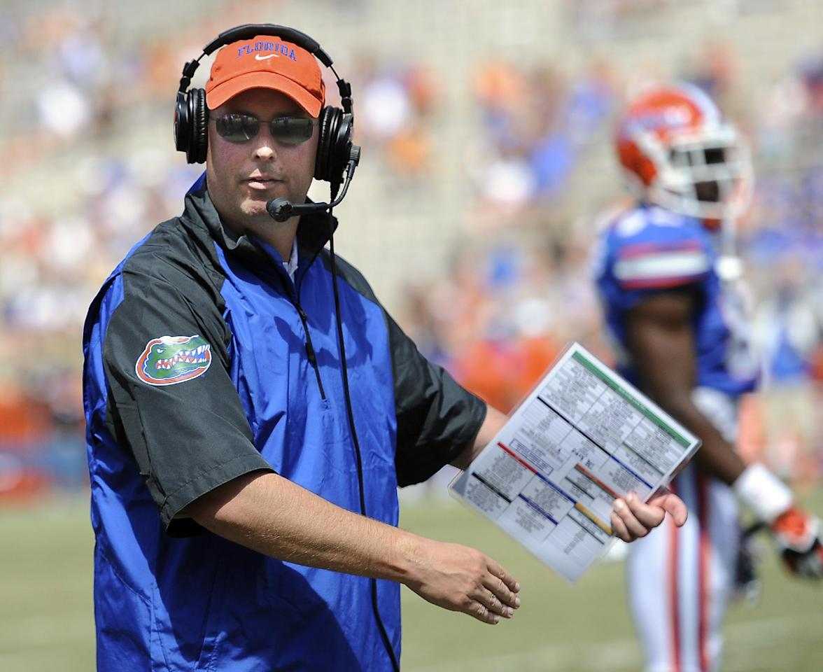 Florida's new offensive coordinator Kurt Roper watches during their spring NCAA college football game Saturday, April 12, 2014, in Gainesville, Fla. (AP Photo/Phil Sandlin)