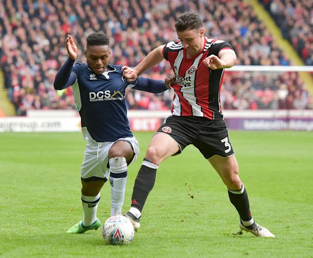 "Soccer Football - Championship - Sheffield United vs Millwall - Bramall Lane, Sheffield, Britain - April 14, 2018 Sheffield United's Enda Stevens in action with Millwall's Mahlon Romeo Action Images/Paul Burrows EDITORIAL USE ONLY. No use with unauthorized audio, video, data, fixture lists, club/league logos or ""live"" services. Online in-match use limited to 75 images, no video emulation. No use in betting, games or single club/league/player publications. Please contact your account representative for further details."