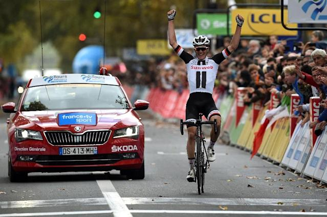 Winning feeling: Soren Kragh Andersen celebrates as he crosses the finish line (AFP Photo/GUILLAUME SOUVANT)