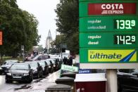 Vehicles queue to refill at a BP fuel station in London