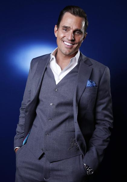 """FILE - This April 2, 2012 file photo shows TV personality and businessman Bill Rancic in New York. Rancic embraces the notion of being part of a power couple with wife Giuliana. Together they have a reality show """"Giuliana & Bill"""" on the Style Network and are in the restaurant business. (AP Photo/Carlo Allegri, File)"""