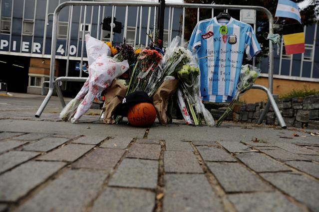 <p>An Argentinian national team jersey hangs at a memorial on West Street two days after a man driving a rented pickup truck mowed down pedestrians and cyclists on a bike path alongside the Hudson River, in New York City, Nov. 2, 2017. (Photo: Lucas Jackson/Reuters) </p>