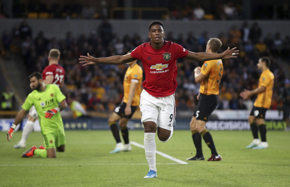 Manchester United's Anthony Martial celebrates scoring his side's first goal of the game during the Premier League match against Wolverhampton Wanderers at Molineux, Wolverhampton, England, Monday Aug. 19, 2019. (Nick Potts/PA via AP)
